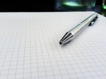 Silver ballpoint pen on white papre royalty free stock photos