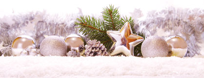 Silver balls and Christmas  decoration  on snow . Royalty Free Stock Images