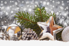Silver balls and Christmas decoration on snow . stock images