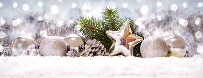 Silver balls and Christmas decoration on snow . Christmas star on snow with silver decoration royalty free stock images