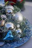Silver balls and Christmas ornaments. In the middle of a table royalty free stock image