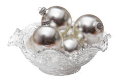 Silver Balls in a Cut Glass Bowl. Silver Christmas tree ornaments in a cut glass bowl stock images