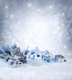 Silver balls and decoration on snow Stock Photo
