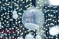 Silver balls with lighting. Sparkle of silver balls with white lighting background royalty free stock photos
