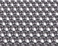 Silver balls pattern reflective texture. Silver metallic ball bearing tightly packed with reflective textures. Silver beads array Stock Photo