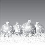 Silver balls in snow Stock Image