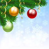 Silver balls with snowflakes ornament. Christmas card with red, yellow and green balls on fir tree branch and blue shiny background Royalty Free Stock Photos