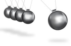 Silver balls swinging concept Royalty Free Stock Photography