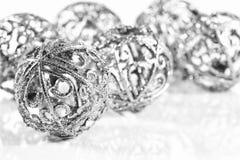 Silver balls on white background stock photos