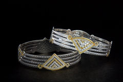 Silver bangles and Gents Kade & x28; Hand Band & x29; Stock Image