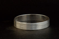 Silver bangles and Gents Kade & x28; Hand Band & x29; Stock Photos