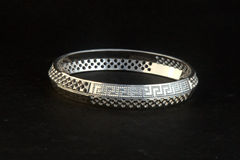 Silver bangles and Gents Kade & x28; Hand Band & x29; Royalty Free Stock Photo