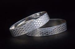 Silver Bangles. WhiteAngle New Design& x27;s Stock Image