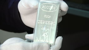 A silver bar possessing the value of deposit stock video