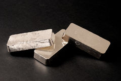 Silver bars. 1 kg bars of 999 silver piled and refleting on each other Royalty Free Stock Photography