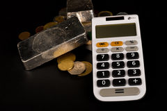 Silver bars and calculator Royalty Free Stock Image