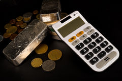 Silver bars and calculator Stock Images