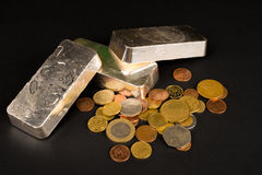 Silver bars and coins still life Royalty Free Stock Photography