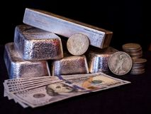 Silver Bars, Silver Coins, and Paper Currency royalty free stock images