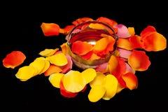 Silver basket on rose textile petals Stock Image