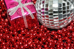 Silver bauble and christmas box Stock Images