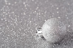 Silver Bauble on Glitter Royalty Free Stock Photo