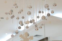 Silver baubles hang from ceiling with snowflake for decorate. Silver baubles hang from ceiling with snowflake for decoration in room hall Stock Photos