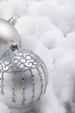 Silver baubles in snow Royalty Free Stock Photos