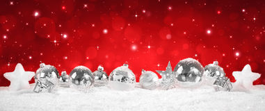 Silver Baubles on snow - red royalty free stock images