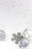 Silver baubles and snowflake Royalty Free Stock Photography