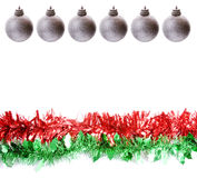 Silver baubles and Tinsel. Row of silver baubles and row of green and red tinsel, with plenty white space for articles, photos or headlines Stock Photos