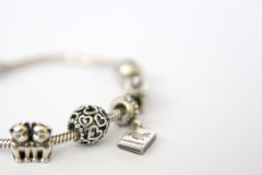 Silver beads and charms Pandora Stock Photography