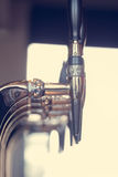 Silver beer taps close up Royalty Free Stock Photography