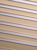 Silver and beige slat background angled right down Stock Image