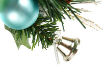 Silver bell, blue bauble on Christmas tree Royalty Free Stock Photos