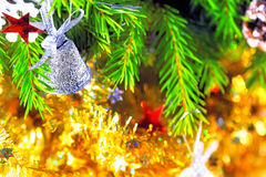 Silver bell on the branch of a Christmas tree Royalty Free Stock Photo