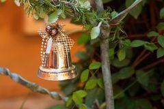 A silver bell on the Christmas tree. Royalty Free Stock Photo