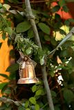 A silver bell on the Christmas tree. Stock Photography