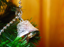 Silver bell on Christmas tree Royalty Free Stock Photography