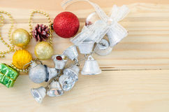 Silver bell with colorful christmas decorations. Royalty Free Stock Images
