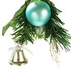 Silver bell, cyan bauble hanging on Christmas tree Royalty Free Stock Photography