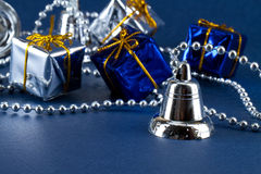 Silver bell and gifts Royalty Free Stock Photography