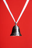 Silver Bell on Red Royalty Free Stock Photo