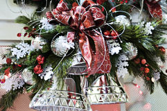 Silver Bells. A christmas decoration with silver bells and red bows Stock Photography