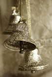 Silver bells. Sepia toned image of three silver bells Royalty Free Stock Image