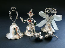 Silver bells. Wedding bells and pacifiers in silver plate Stock Photography
