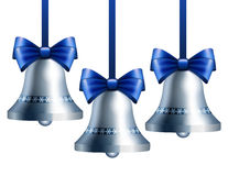 Silver bells with blue ribbon Royalty Free Stock Image