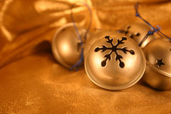 Silver Bells on Gold. Silver Christmas Bells on Gold background Royalty Free Stock Image