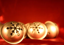 Silver Bells on Red. Christmas bells on red royalty free stock photography