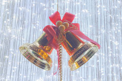 Silver bells with red ribbon Stock Images